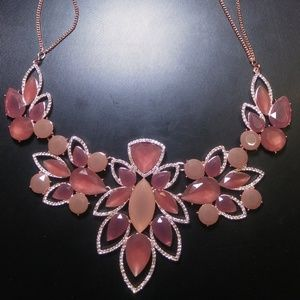 Rose Gold Necklace Filled With Many Cuts of Stones